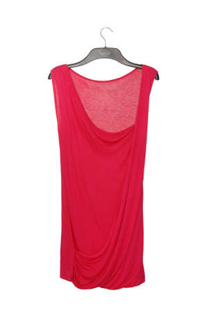 isolated asymmetrical red blouse, asymmetric fashionable top, female clothes on white background, clothing as single object, cotton tunic on clothes hanger 免版税图像