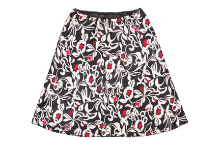 bellbottoms skirt isolated on white, silk black and white skirt as a single object, satin flared skirt with large pattern, female trendy bell skirt, graceful glamor clothing, spiffy petticoat with red pattern 免版税图像