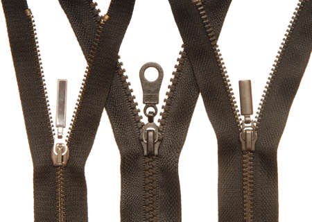 isolated black zipper on white background, close-up of fasteners for clothes, still life of sewing futniture, metal accessories, three zippers 免版税图像