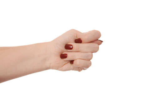 female hand shows fig sign, fingers on white background, obscene gesture as single object, isoleted girl's palm, it is used when denying a request, sign language; rude gesture, concept of negative communication, fig-hand