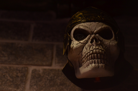 Skull of a Roman soldier with centurion helmet on halloween.