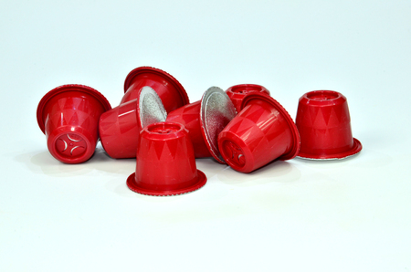 Collection of espresso coffee capsules red isolated on white background, Closeup view with details.
