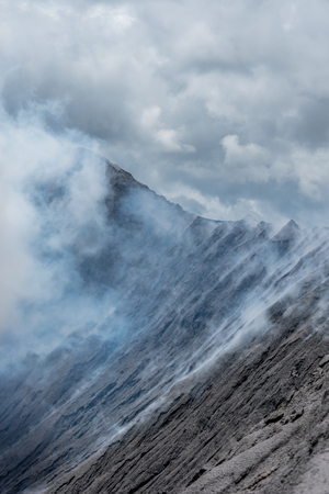 Standing at the Edge of the Vulcano Mount Bromo, Indonesia, Asia Stock Photo