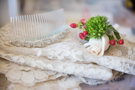 Detail of wedding bride's white veil, with accessories
