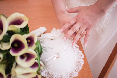 Hands detail with bride putting the engagement ring on the other hand Standard-Bild