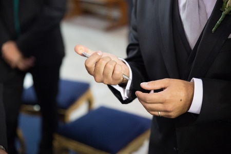 Hand detail. Groom signing the wedding contract