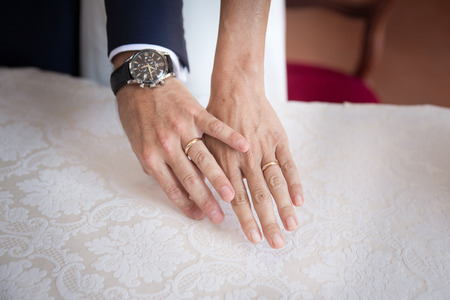 Hands detail with wedding rings exchange, during a wedding