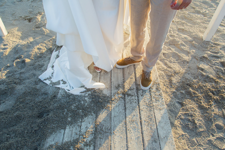 Close up of bride's and groom's shoes