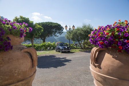 Fiat 500 on a wedding day, with landscape, in the south of italy