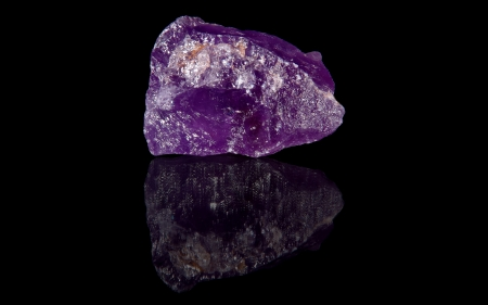 amethyst rough: Amethyst  raw mineral stones with reflection on black background