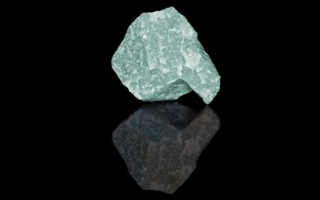 aventurine: Aventurine green  raw mineral stones with reflection on black background
