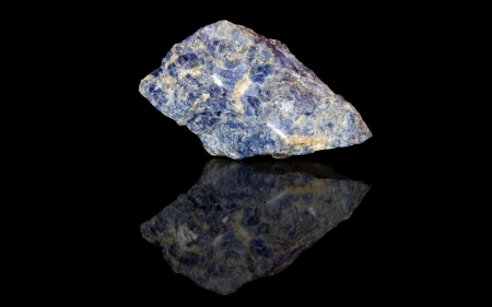 sodalite: Sodalite  raw mineral stones with reflection on black background Stock Photo
