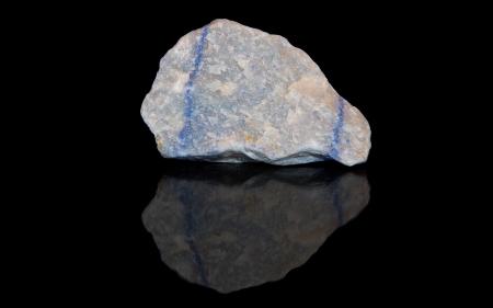 aventurine: Aventurine blue raw mineral stones with reflection on black background
