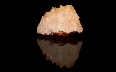 calcite: Calcit raw mineral stones with reflection on black background Stock Photo