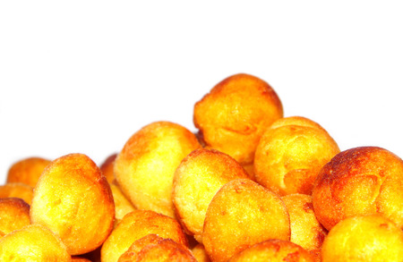 Fried potato croquettes on white background photo