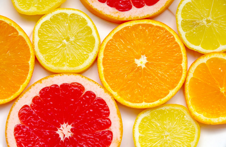 Sliced ​​grapefruit, orange and lemon as a background