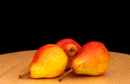 Three pears on a black background Stock Photo