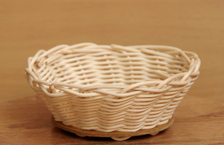 basket weaving: Basket weaving from rattan on the table.
