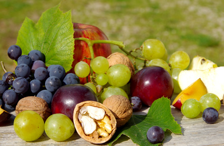 Diverse natural autumn fruits on the table. Stock Photo
