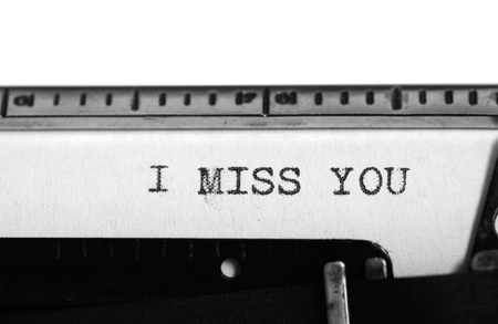 i miss you: Typewriting on an old typewriter. Typing text: i miss you Stock Photo
