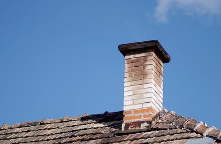 Repaired an old chimney on the roof of the old.