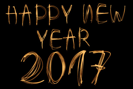Happy new year 2017 written with light on black background Stock Photo
