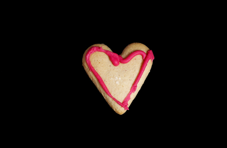 Gingerbread heart-shaped on black background