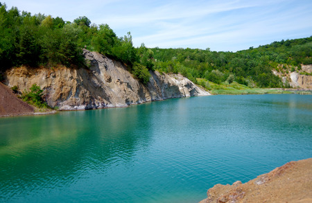 Quarry landscape with green lake