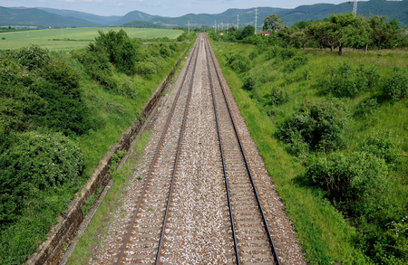 The double railway line in transit through a nature