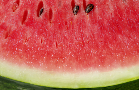 Detail of red watermelon with black pips