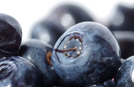 Fresh natural antioxidant blueberries pile, close up