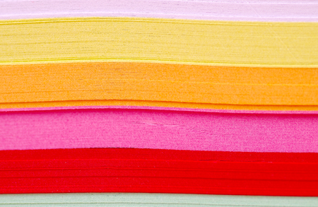 Detail of colorful papers placed on themselves