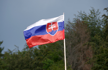 Slovak flag blowing in the wind on sky background