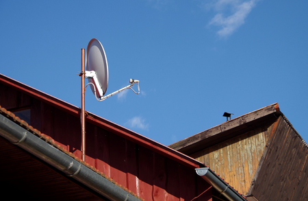 Satellite on the roof and blue sky Standard-Bild