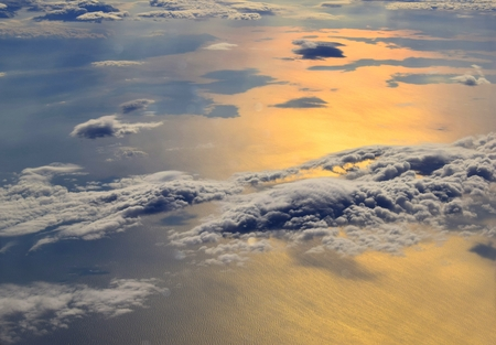 Sunrise over the sea and clouds Stock Photo