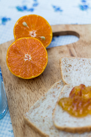 consists: Breakfast consists of bread with oranges.