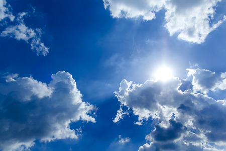 hides: Sun beam hides behind the clouds.Effect lens flare.