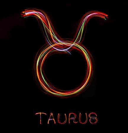 Zodiac sign from led light on black background.