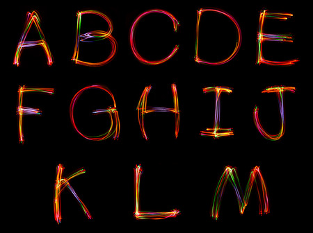 Word writing from light on the black background.