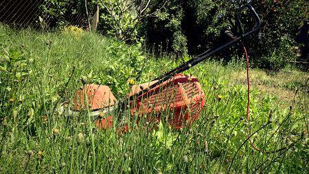 Lawn mower in high grass