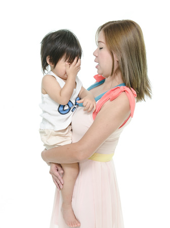 Mother and asian baby crying photo