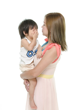 scolding: Mother and asian baby crying Stock Photo