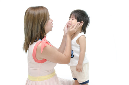 crying girl: Mother and asian baby crying Stock Photo