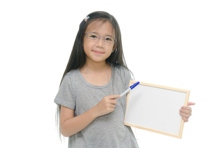 Little Asian girl holding empty whiteboard on white background Imagens