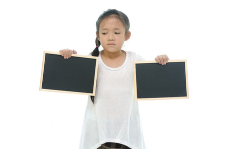 Little asian girl holding two black boards on white background photo