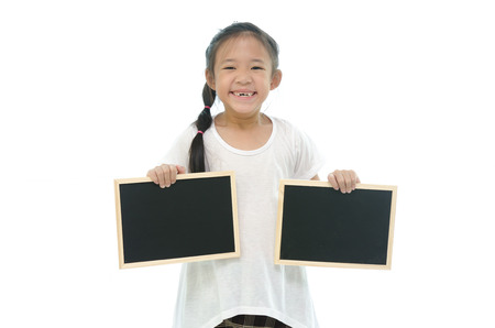 black boards: Little asian girl holding two black boards on white background Stock Photo