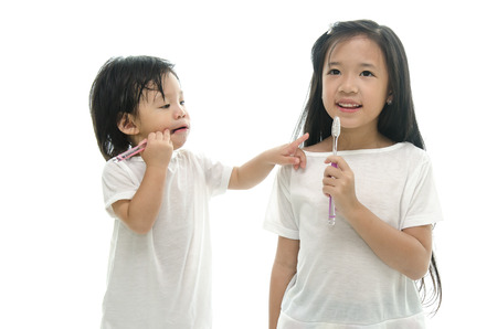 Little  asian girl and boy brushing teeth,missing teeth photo