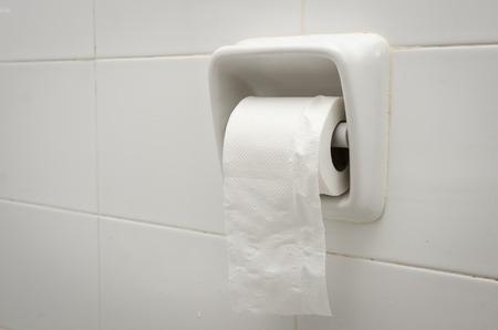 White ceramic toilet paper holder photo