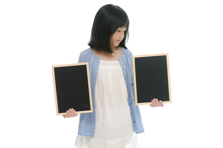Beautiful asian girl holding  two chalk board on white background isolated photo