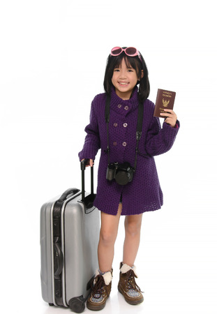 Beautiful asian girl with  baggage,holding passport on white background isolated photo